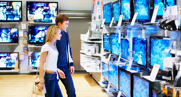 Young couple in consumer electronics store looking at latest television
